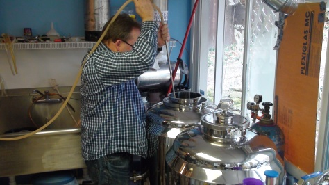 Sanitizing the new fermentors.  We need a bigger pump for the sprayballs and the little one on the brewery doesn't cut it.