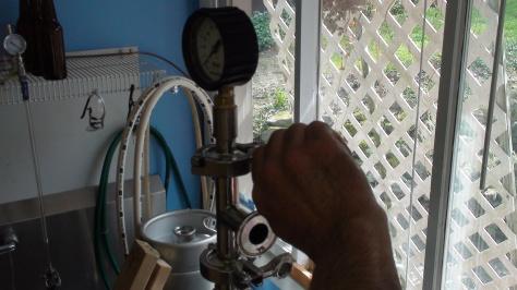 Attaching pressure gauge.