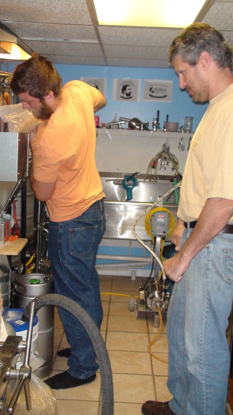 Jesse and John milling the grain.