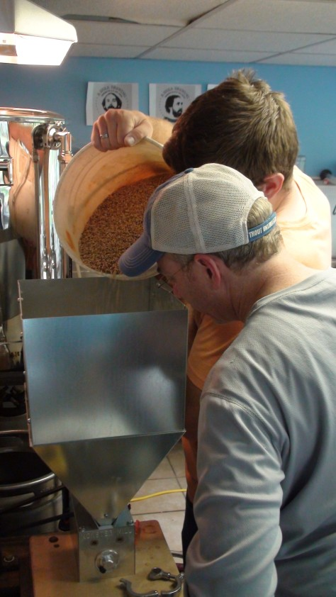 Jesse and Michael grinding the grain for the second batch.  Wheat beers are a little tougher on the grain mill.  It got stuck a few times.