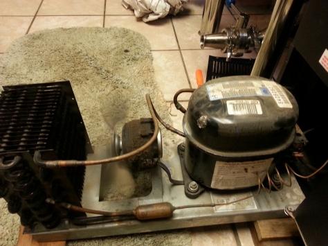 Beverage Air kegerator compressor, fan and radiator housing.