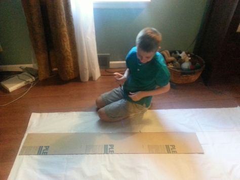 Beginning work on the large window treatments...measuring them to cut down to size.