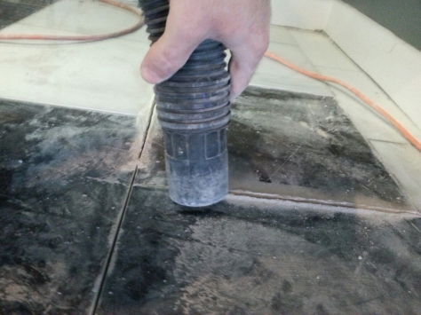 You have to make sure to vacuum the loose grout to get the grout remover blade deep enough.