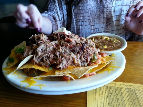 Yes, that is a mountain of pulled pork.  If you like pulled pork with enough leftovers to make two sandwiches, get this.  My wife didn't care for the salsa though I liked it on it's own.  We preferred the BBQ sauce.