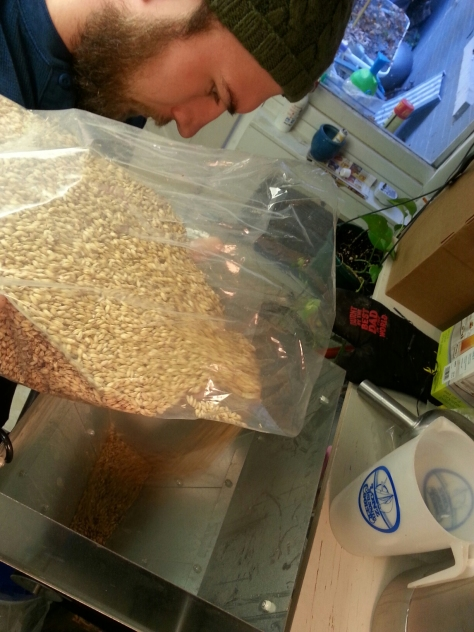 Milling the grains for our two batches today.