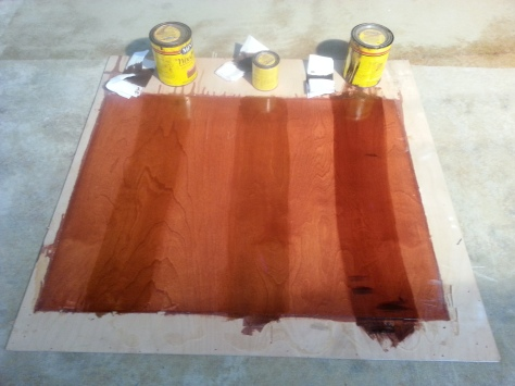 Comparing various stains over existing stain to 'de-redden' the current scheme.