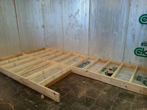 """Building a frame of 2"""" insulation board inside a 2x8 frame with 2x4s as cross braces."""