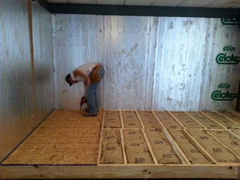 John laying the subfloor.