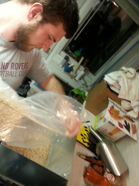 Jesse milling the grains.