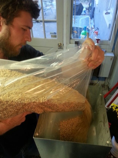 Jesse beginning the grinding of the grains.  This one was a little tough with all the crystal malts.  I need to get a tension adjustment pulley.