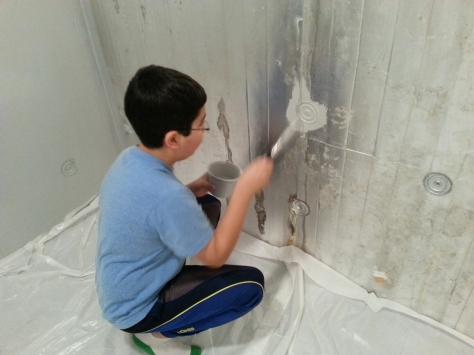 Trevor applying paint to the corners and 'irregular' surfaces.