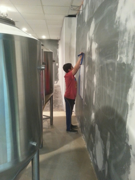 Trevor applying painters tape to areas not needing paint.  This was a good job for him as he is detailed-oriented.