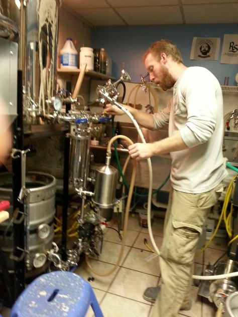 Myself on the pumpout of the pale ale using the Hop Rocket with some Simcoe whole hops.