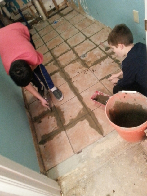 Trevor and Devin grouting.