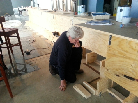 Dad doing the plywood facing on the bar.