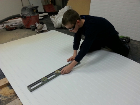 Devin starting some measurements on the women's bathroom beadboard.