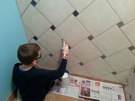 Sealing the grout for water protection.