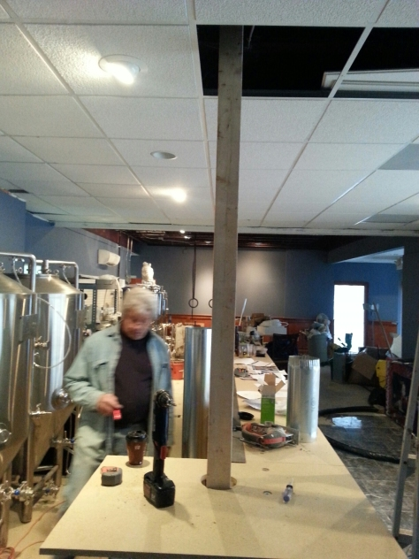 We decided to run the glycol-cooled beer lines through the drop ceiling into the cooler.