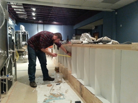 Jesse on the FRP back-bar install.