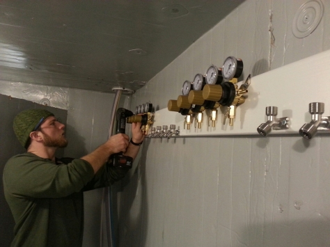 Jesse hooking up the CO2 manifold and regulators in the cooler.