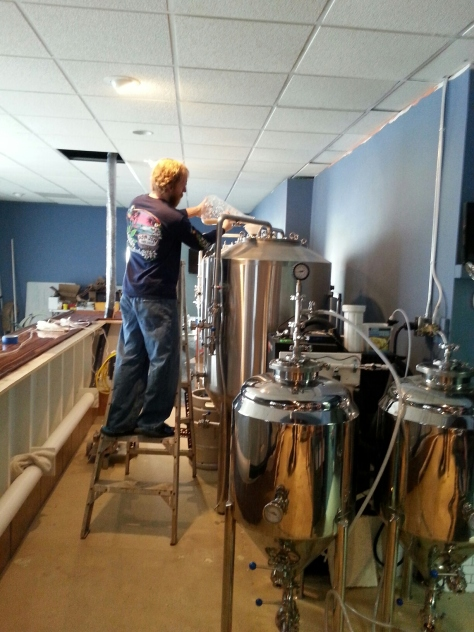 Adding yeast to the beer...from a ladder!